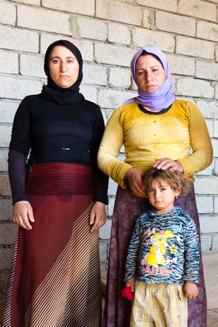 Photo of a Syrian family experiencing Christian persecution.